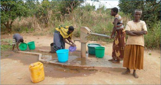 Villagers from Likwakwanda now enjoy clean water from the Rotary Well, as seen in this photograph.