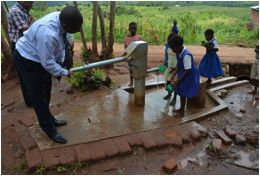 Children using the newly constructed deep well.